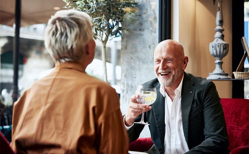 older couple having drinks